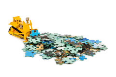 Toy bulldozer and puzzle Stock Images