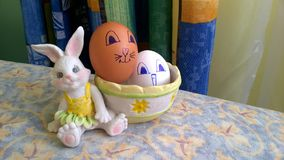 Toy bunny with basket and easter eggs stock photo