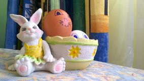 Toy bunny with basket and easter eggs royalty free stock photography