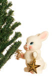 Toy bunny and Christmas tree Royalty Free Stock Images