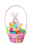 Toy Bunny and Colorful Basket full of Chocolate Easter Eggs. A Toy Bunny and Colorful Basket full of Chocolate Easter Eggs, along with Happy Easter writing Stock Photos