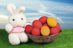 Toy bunny and Easter eggs. Over blue sky Royalty Free Stock Photos