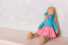 Toy bunny sitting on the wooden floor Stock Photography