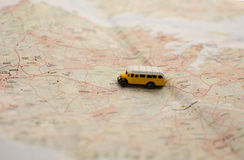 Toy bus. On the map Royalty Free Stock Image
