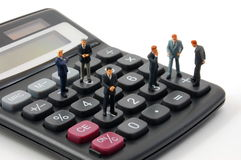 Toy business man on calculator isolated Royalty Free Stock Photos