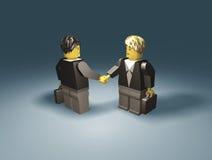 Toy business people handshake vector illustration