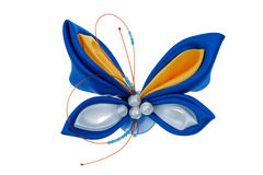 Toy butterfly made of ribbons Stock Photos