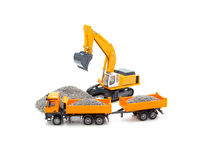Toy cable excavator and heavy truck Stock Photo