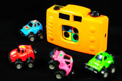 Toy camera and car model Stock Image