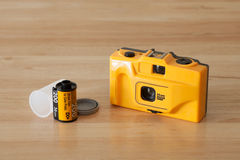 A toy camera and films. Many professional photographers have used toy cameras and exploited the vignetting, blur, light leaks, and other distortions of their Royalty Free Stock Image