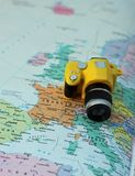 Toy camera on the map of Europe and Italy Royalty Free Stock Photography