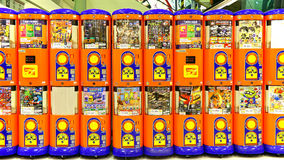 Toy capsule vending machines. Rows of colorful coins or tokens operated toy wending machines at a toy store in hong kong Royalty Free Stock Photos