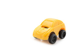 Toy car. Single yellow toy car over white background royalty free stock photos