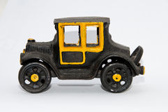 Toy car. Very old authentic toy car in cast iron Stock Photo