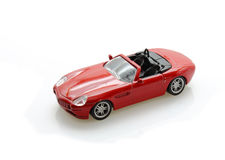Toy car. Isolated red toy car on white royalty free stock photos