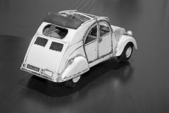 Toy car. Old toy car on desk royalty free stock image