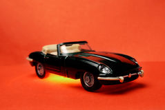Toy car. Small toy metal prototype of old car with vinyl highlighting Royalty Free Stock Image