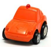 Toy Car. Tiny orange toy car for fun stock image