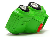 Toy Car. Tiny green toy car overturn Royalty Free Stock Photos