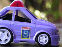 Toy Car. Side view of a plastic toy police car Royalty Free Stock Photo