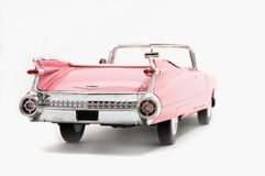 Toy car. Pink cadillac toy on white stock images