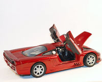 Toy Car. This is a shot of a red toy car. Off white is the background color Stock Image