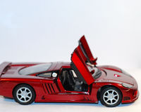 Toy Car. This is a shot of a red toy car. Off white is the background color Royalty Free Stock Photos