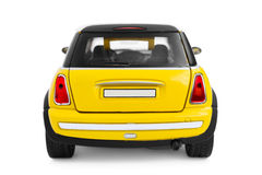 Toy car. Yellow model car - back view Royalty Free Stock Photos