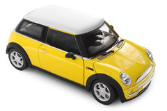 Toy car. Yellow model car - side view Royalty Free Stock Photo