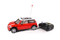 Toy car. A beautiful car and remote control toy with white background royalty free stock photo