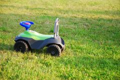 Toy - car. A kid's toy in the meadow Royalty Free Stock Photos