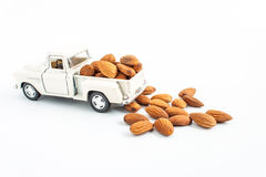 Toy car with almonds bean on white background. Almonds, toy car with almonds bean on white background Royalty Free Stock Photos