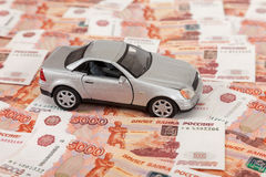 Toy car on the background of banknotes Royalty Free Stock Images