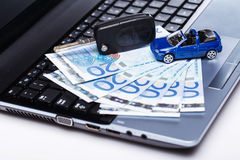 Toy car and banknotes Royalty Free Stock Images