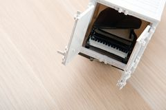 Toy car black piano table stock photo