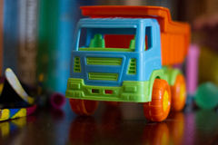 Toy car. Bright children`s toy machine close-up Stock Image