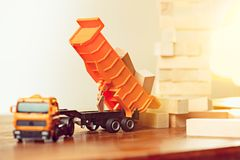 The toy car and building truck on wooden table stock photography