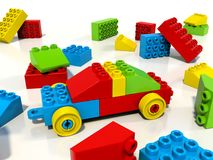 Toy car built from colorful blocks, lego style. A toy car built from lego style colorful blocks, and random bricks scattered around. Shiny plastic material, red Stock Images