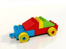 Toy car built from colorful blocks, lego style, single object. A toy car built from lego style colorful blocks. Shiny plastic material, red, blue, yellow and Stock Photo