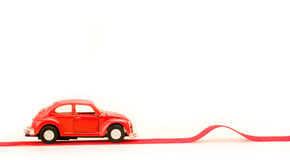 Toy car and bump. Red toy car heading for a bump Stock Images