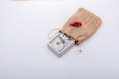 Toy car and bundle of US dollar in a sack Royalty Free Stock Photography