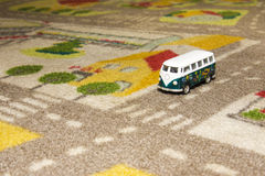 Toy car (bus) on carpet Royalty Free Stock Image