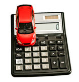 Toy car and calculator. Stock Photography