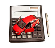 Toy car and calculator over white. Stock Image
