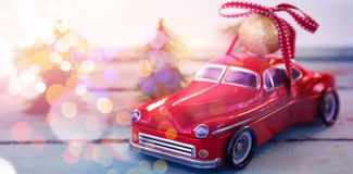 Toy Car Carrying Christmas Bauble Ball On Wooden Plank Stock Photos