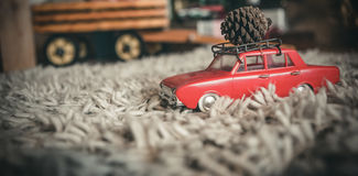 Toy car carrying christmas pine cone Stock Photography