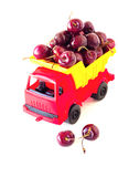 Toy car with a cherry in the white  background Stock Photos