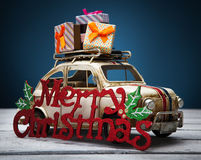 Toy car with Christmas gift Royalty Free Stock Image