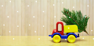 Toy car and christmas tree Stock Photo