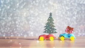 Toy Car with Christmas tree and gift box. Christmas landscape with gifts and snow. Merry christmas and happy new year greeting car Stock Image